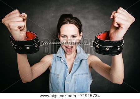 Arrest. Criminal Woman Prisoner Showing Handcuffs