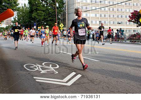 Senior Woman Runs In Atlanta Peachtree Road Race