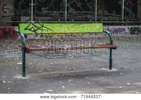 Totally spray painted park bench in ghetto territory. poster