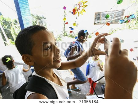 Unidentified Children Playing In School Located In Favela