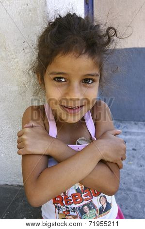 Unidentified Girl Playing In Favela Rocinha