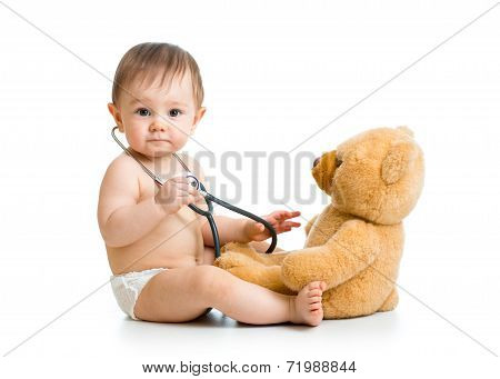 Cute Baby Boy Weared Diaper With Stethoscope And Toy