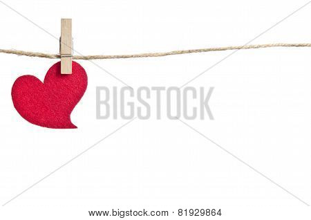 Red Fabric Hearts Hanging On The Clothesline . On White Background