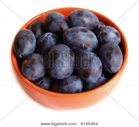 Plums On The Plate With Drops