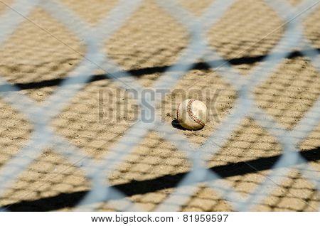 Baseball throught fence