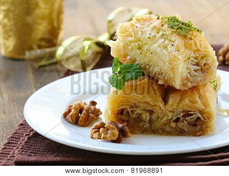 Turkish arabic dessert - baklava with honey and walnut nuts