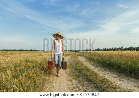 Teenage Boy Traveling By Foot On Country Road