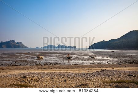 Ebb tide and small boats at Cat Ba island in Vietnam