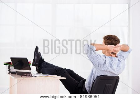 Back side photo of relaxed business man on headchair