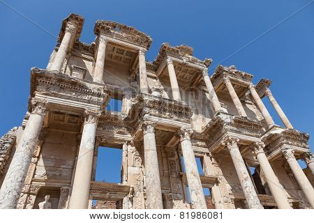 Roman Library of Celsus in Ephesus against clear blue sky poster