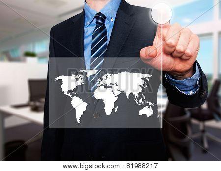 Businessman in dark suit pushing button worldmap global communication