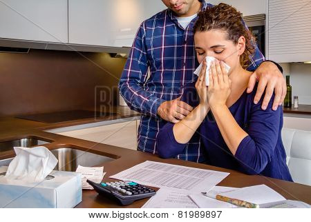 Desperate young woman with debts reviewing the bills