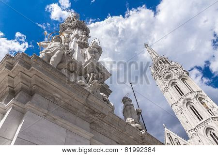 White Plague Column In Budapest Against The Backdrop Of The Cathedral Of St. Matthias