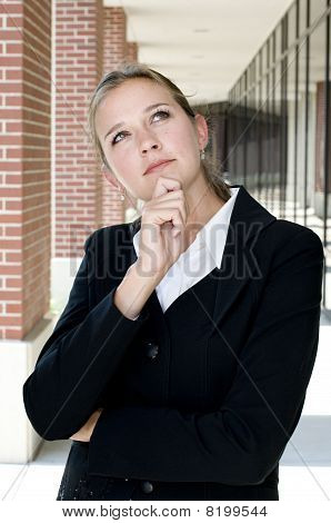 Attractive Businesswoman In Thoughtful Pose