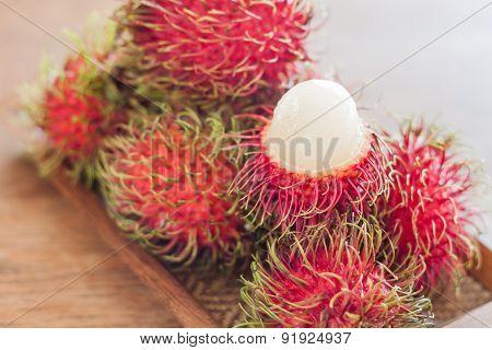 Fresh Rambutans On Wodden Tray