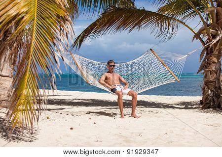 Man In A Hammock On The Beach