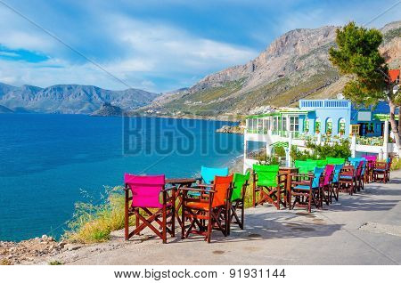 Colorful wooden tables and chairs on Greek Island