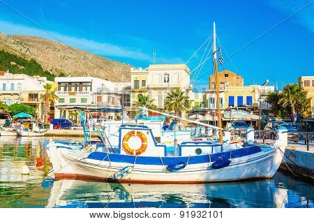 Blue-white wooden boat moored in Greek port