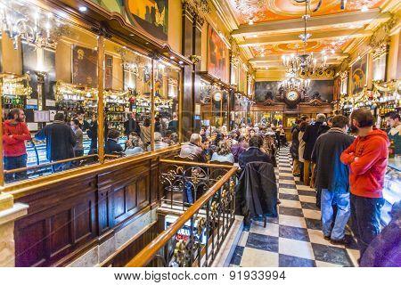 People Enjoy The Cafe A Brasileira In Lisbon