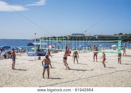 People Playing Volleyball On Copacabana Beach Rio De Janeiro Brazil