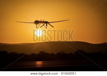 An unmanned drone low pass in sunset