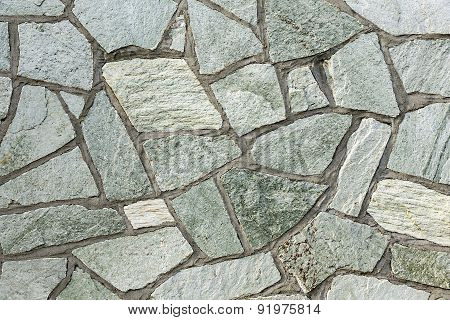 Section Of Flagstone Wall With Varying Shapes And Lines