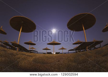 Beach Umbrellas at Moon Light Wallpaper