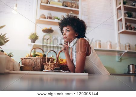 African Female Juice Bar Owner Looking Away And Thinking