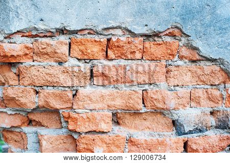 Vintage tone Cracked Old Brick wall for background.