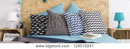 Trendy arrangement of double bed patterned cushions
