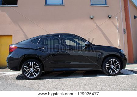 Saverne, Bas-Rhin, France - May 7, 2016: Black BMW X6 parked on the side of the street in the city of Saverne.