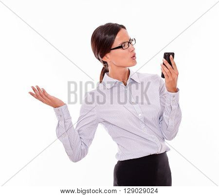 Angry Brunette Businesswoman With Cell Phone