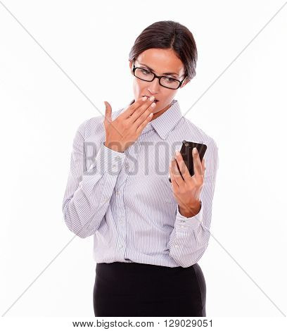 Shocked Brunette Businesswoman With Cell Phone