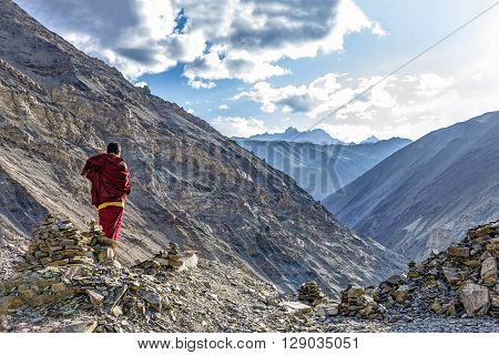 Rizong, India - August 17, 2015: View of buddhist monk in meditation over the Rizong monastery gorge. Rizong monastery is situated at the top of a rocky side valley on the north side of the Indus.