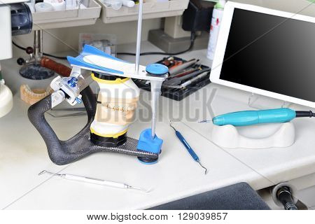 gypsum model of jaw and basic dentist tools poster