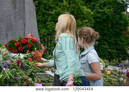 DNEPROPETROVSK, UKRAINE - 09 MAY: People are laying flowers to Glory Monument in Victory Day on 09 May, 2016 in Dnepropetrovsk, Ukraine.