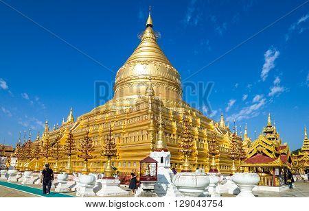 Bagan Myanmar - January 12 2012: Tourists around the Kuthodaw temple.