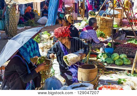 Inla Lake. Myanmar - January 14 2012: Shan State local people in the street market