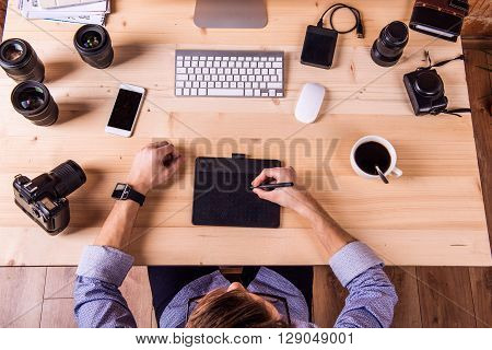 Photographer At The Desk, Office Gadgets And Object Lens