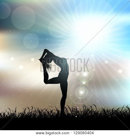 Silhouette of a female in a yoga pose in a sunny landscape