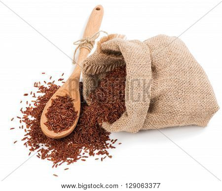 Raw grain unpolished red rice grains in burlap bag isolated on white background.