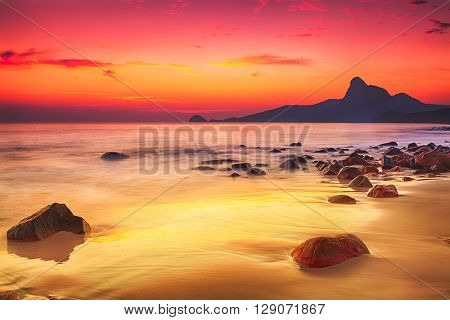 Sunrise over the sea. Stone on the foreground