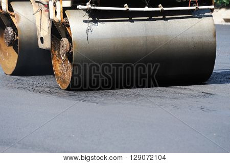 close up on compactor paving the asphalt road