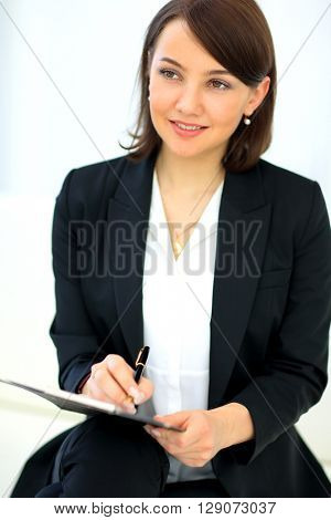 Portrait of happy smiling business woman with black folder