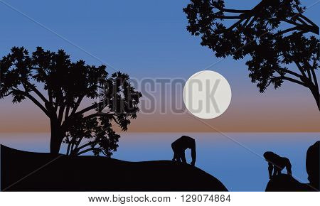 Illustration of gorilla silhouette with moon at the night