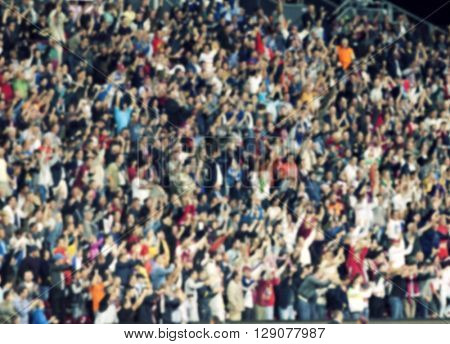 crowd of soccer fans at the stadium - defocused background