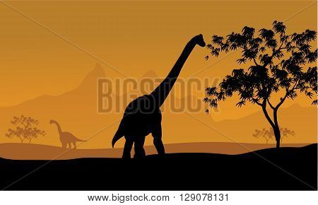 beautiful sunrise and the silhouettes of dinosaurs