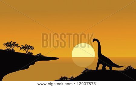 silhouette of brachiosaurus in river with brown backgrounds