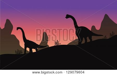 Silhouette of brachiosaurus with purple backgrounds at the afternoon