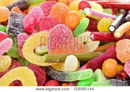 closeup of a pile of different candies, with different shapes and flavors